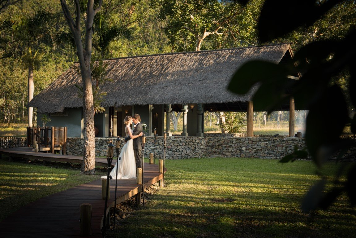 Whitsundays Wedding Venue with bride and groom by the pool