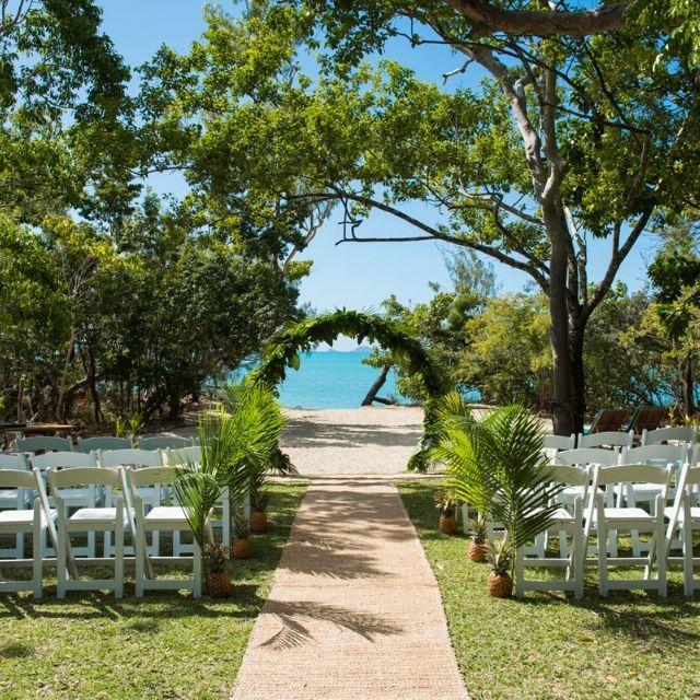 Wedding Ceremony at Paradise Cove Resort with tropical styling overlooking the ocean