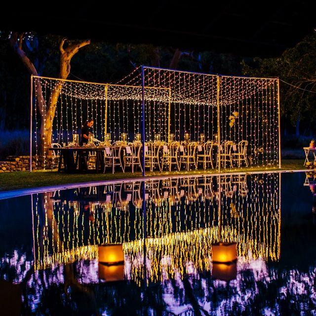 Wedding Reception dinner set up with fairy lights poolside