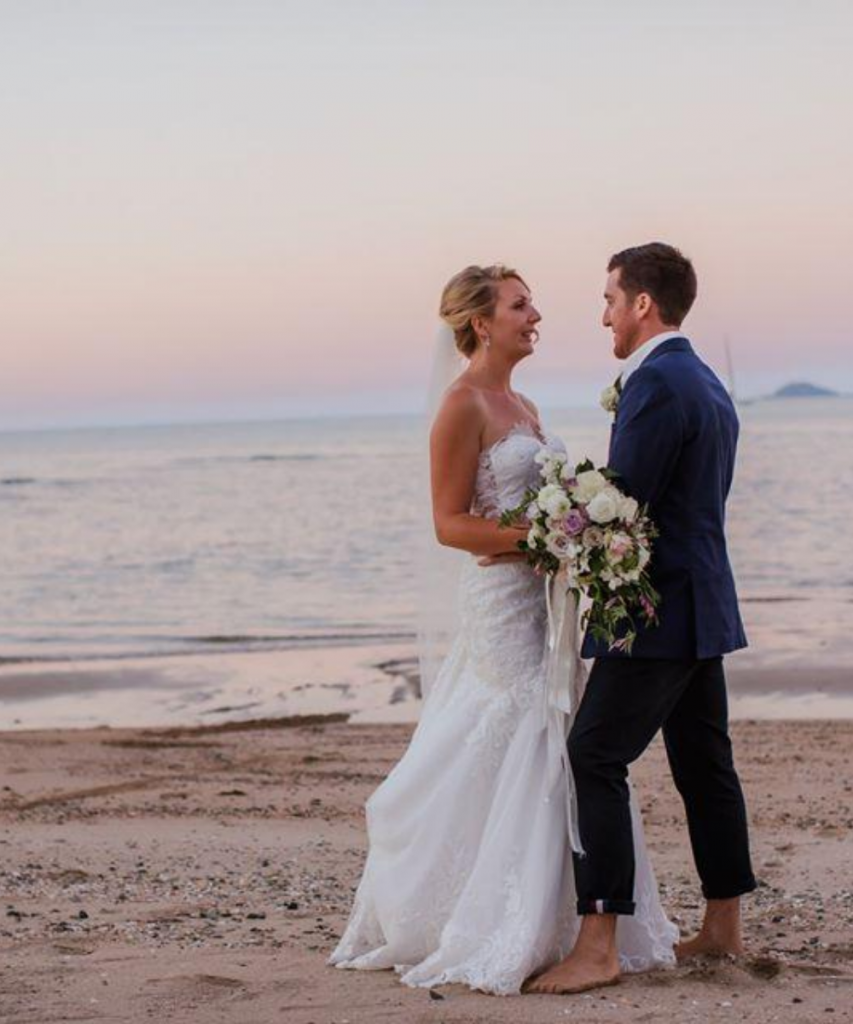 Bride and Groom on a beach at sunset at Paradise Cove Resort, Whitsundays