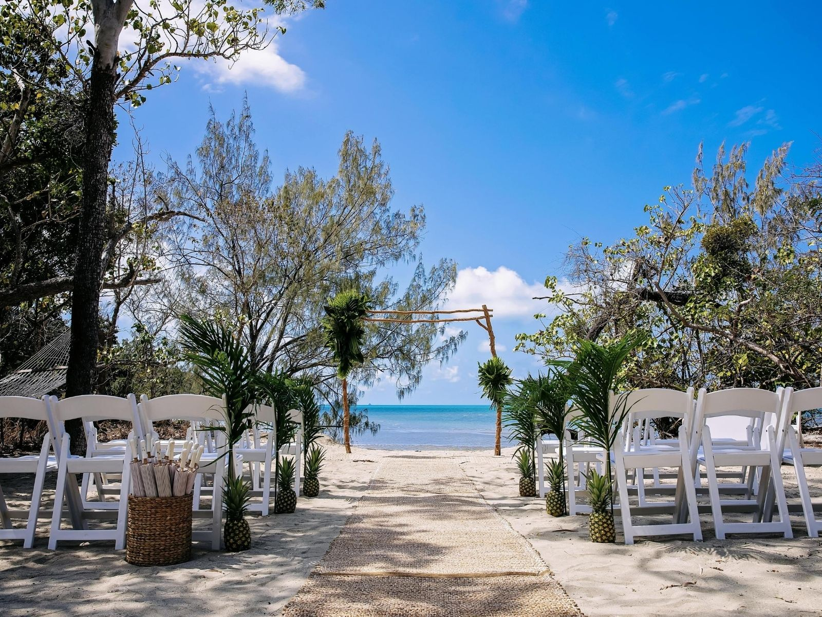 wedding ceremony set up on a beach at Paradise Cove Resort
