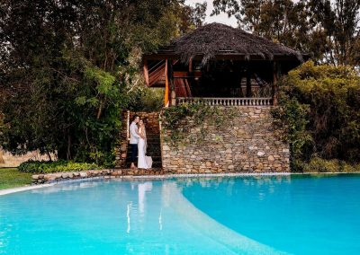 Bride and Groom at Paradise Cove Resort by the pool