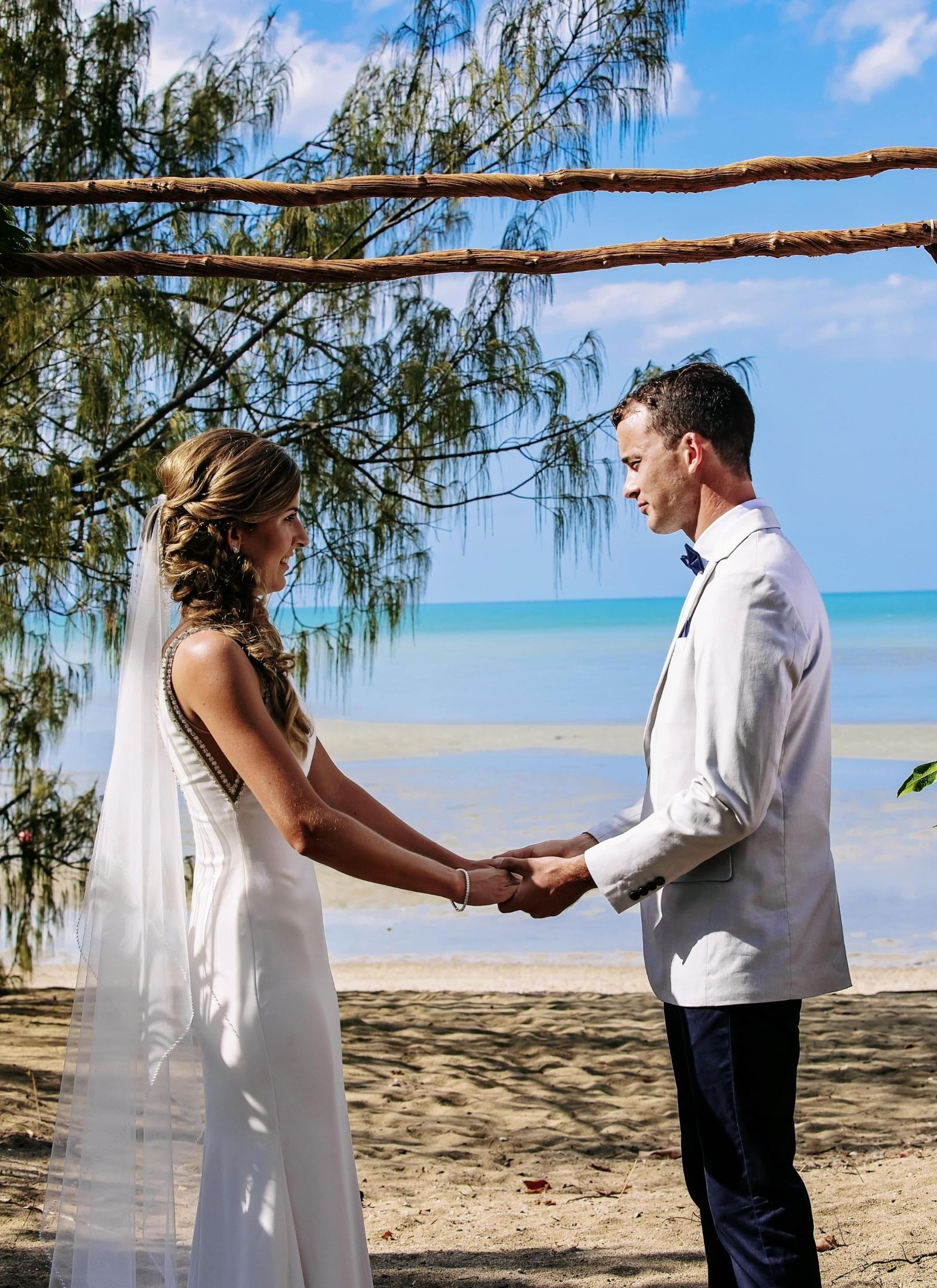 Bride and groom during wedding ceremony at Paradise Cove Resort