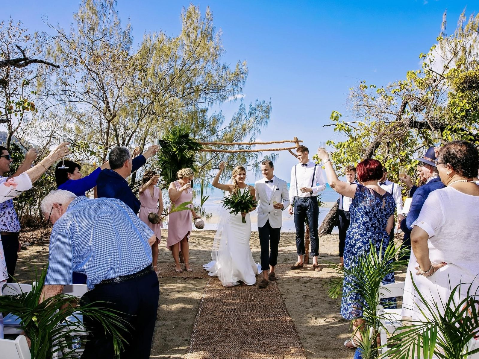 Bride and Groom celebrating at Paradise Cove Resort after wedding ceremony