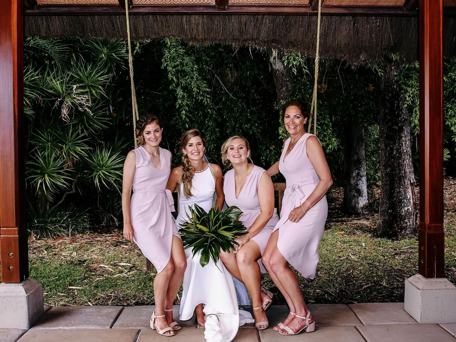 Bride and Bridesmaids on swing at Paradise Cove Resort