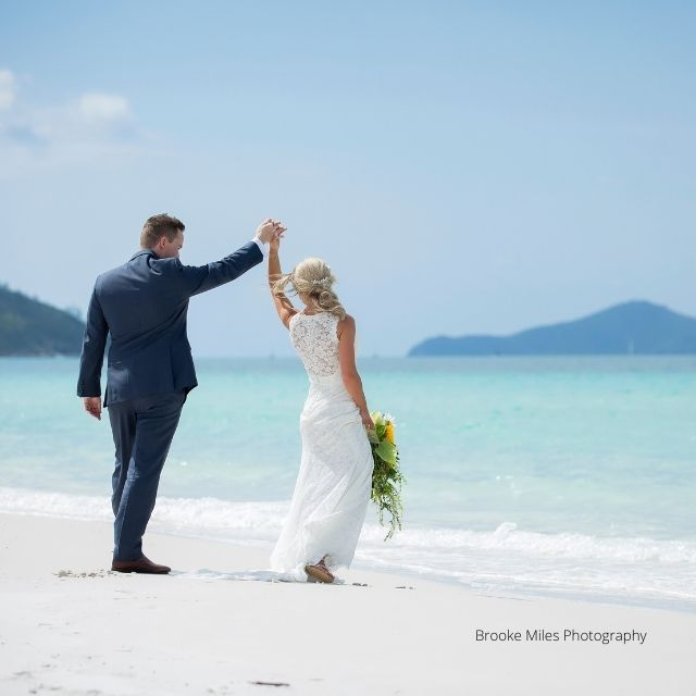 Bride and Groom dancing on a white beach