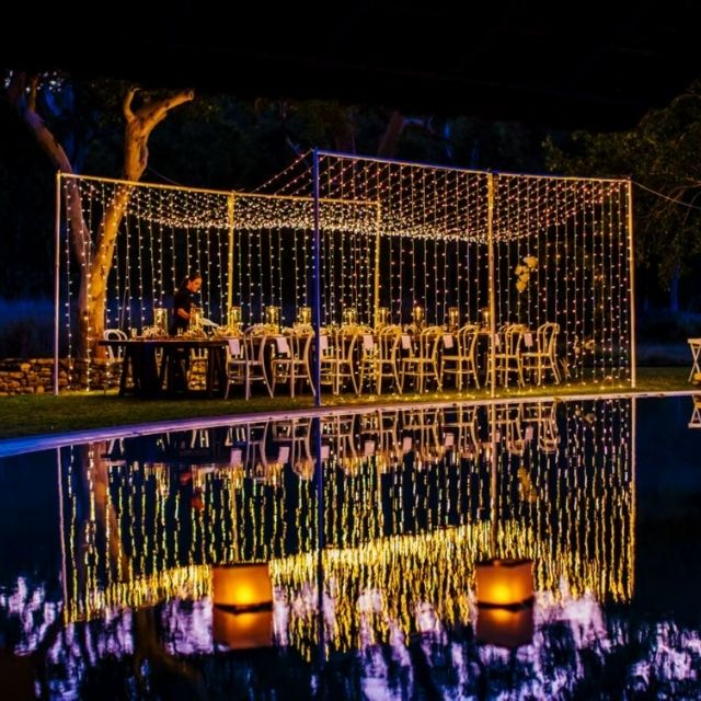 Poolside wedding reception with fairy lights