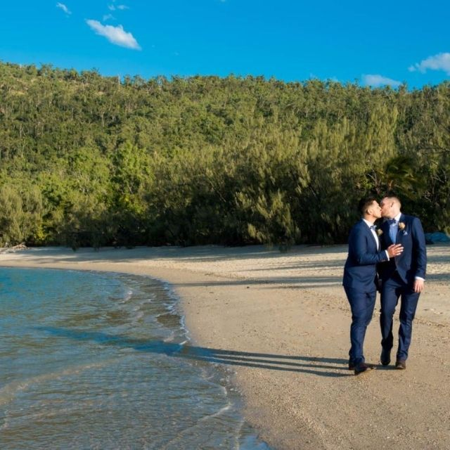 Two grooms on the beach at Paradise Cove Resort