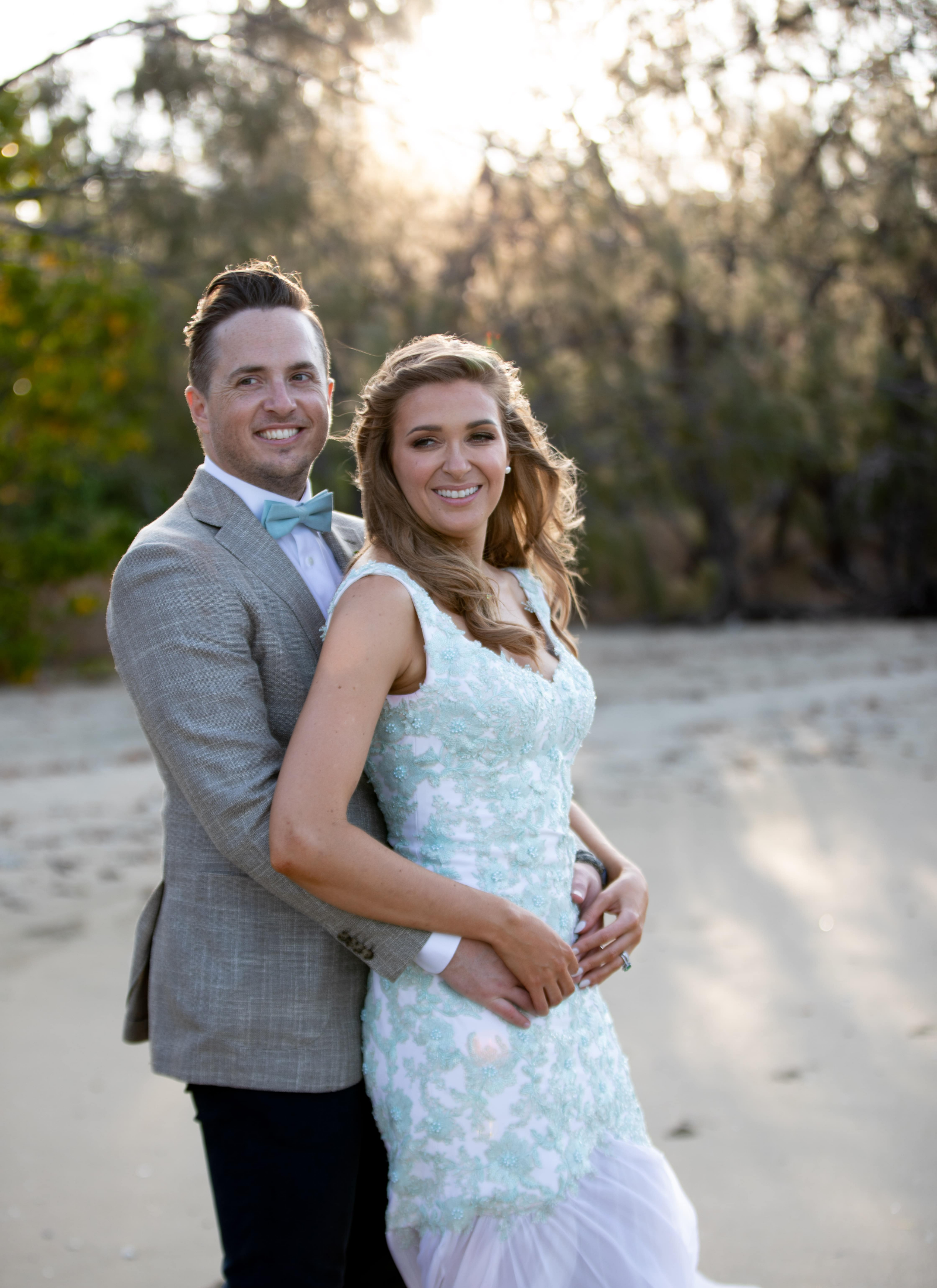 Bride and Groom standing on beach at Paradise Cove Resort