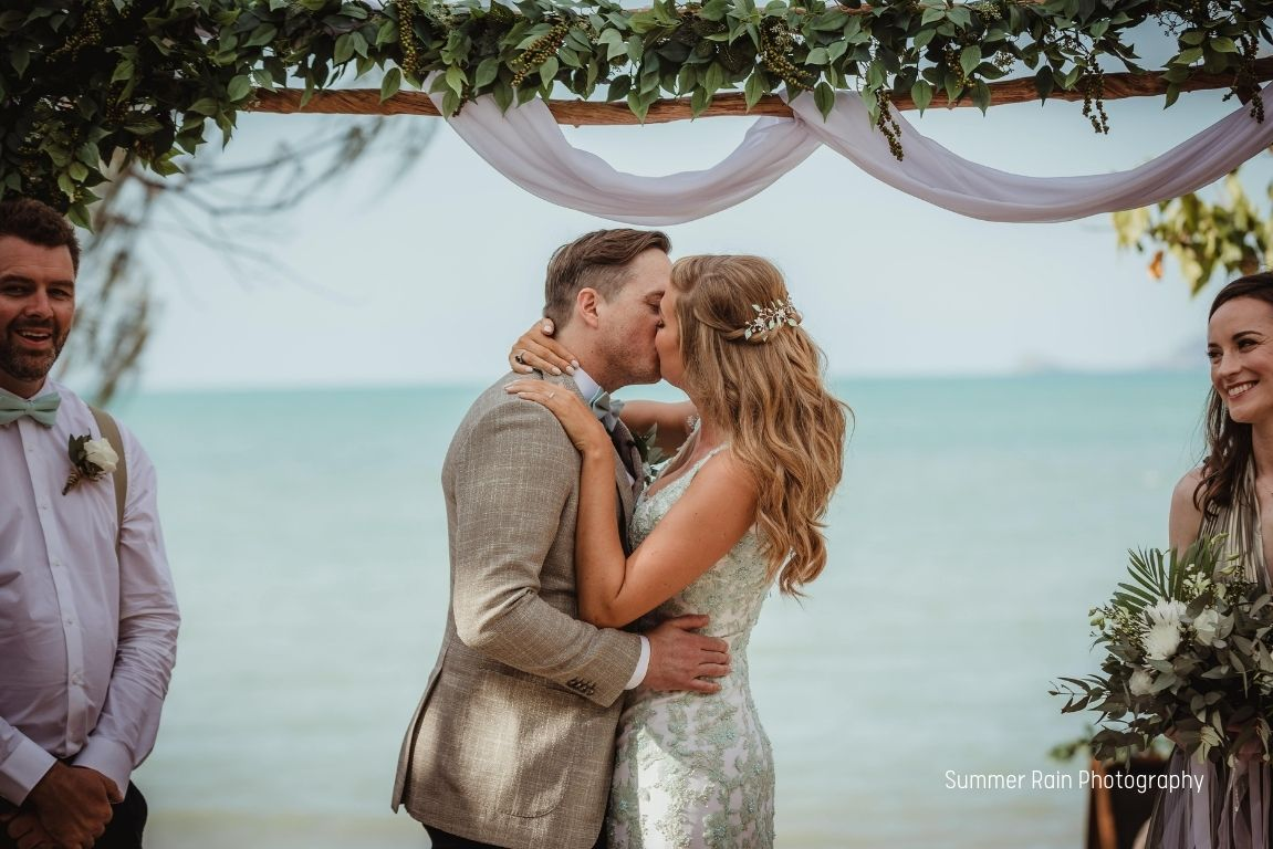 Bride and Groom by a pool and wedding reception at Paradise Cove Resort